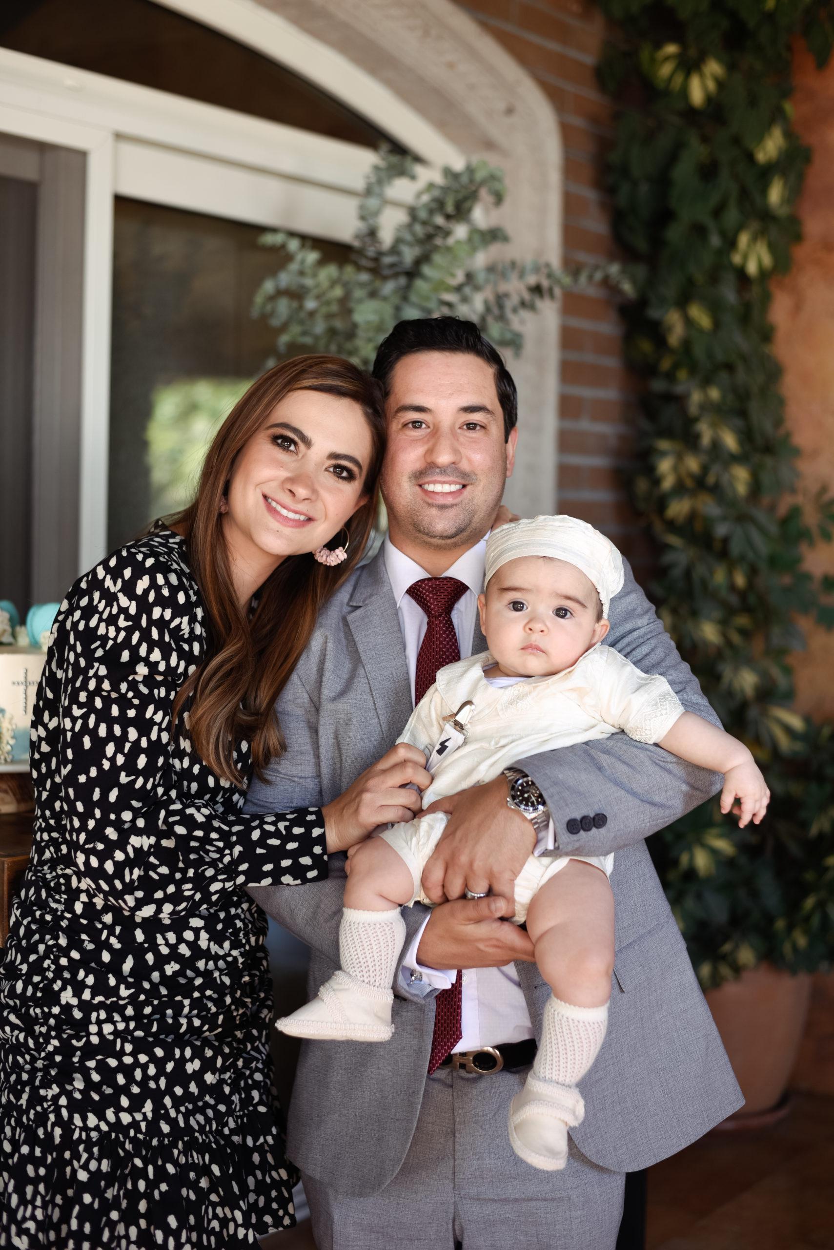 Jorge con sus padrinos.