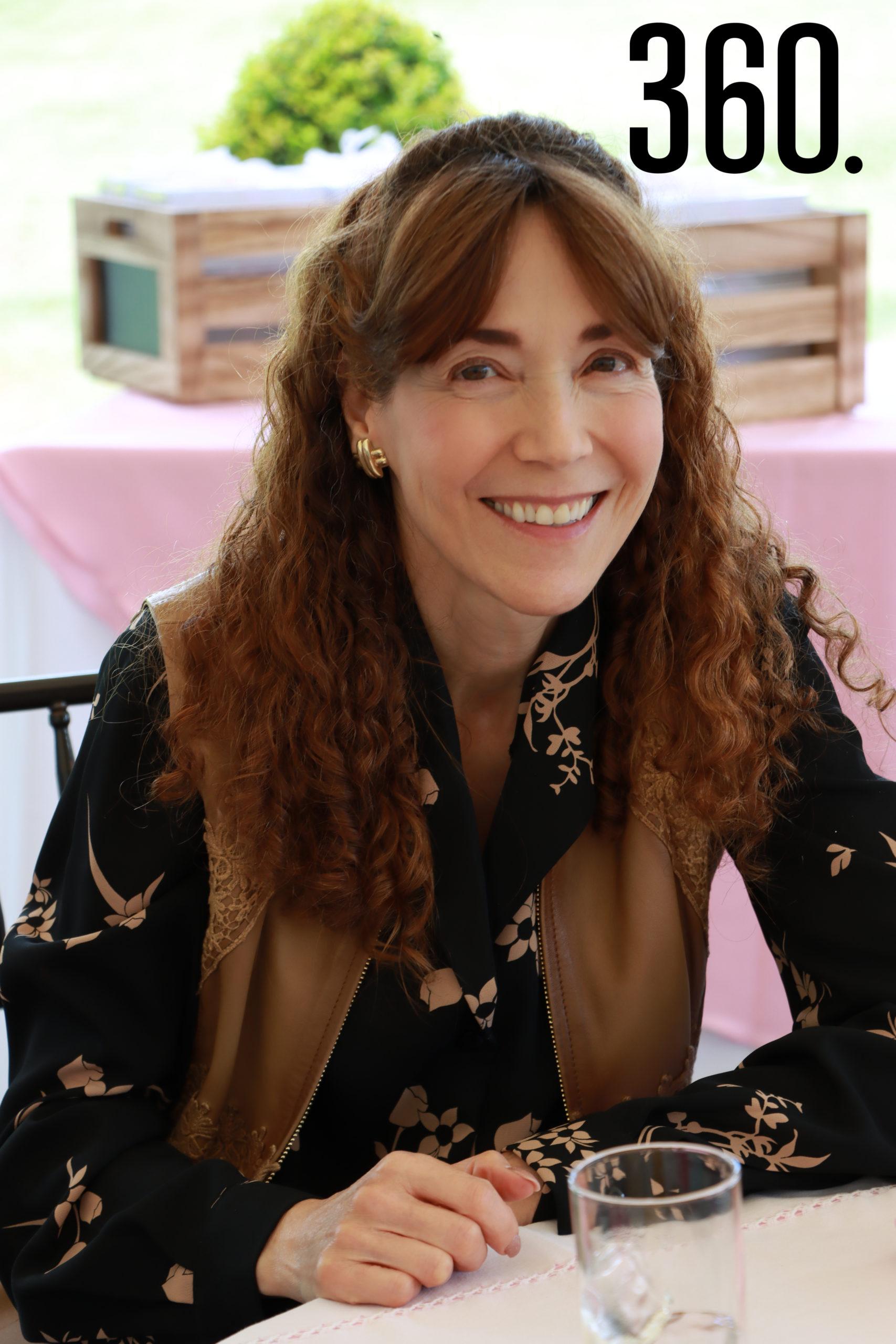 María Elena Romero.