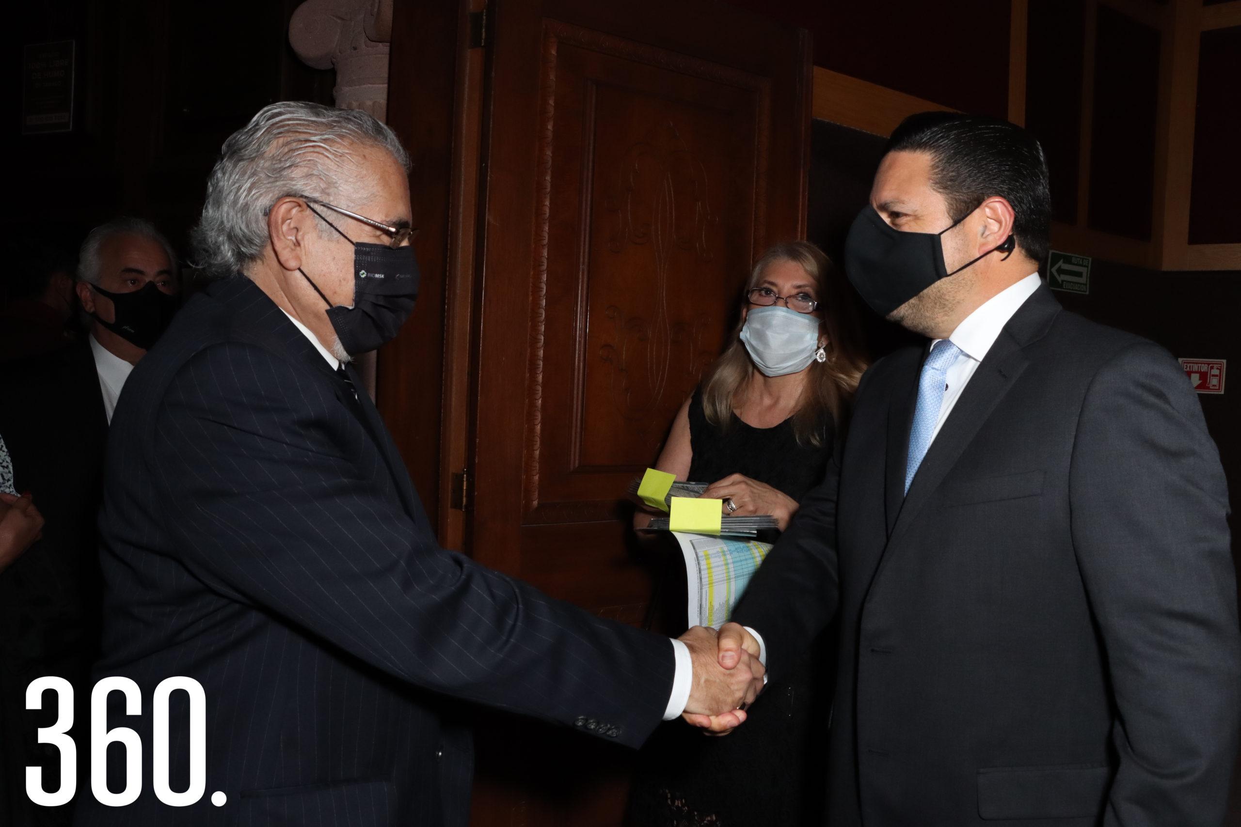 Roberto Magdaleno y César Cantú.